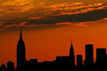 NEW YORK - SEPTEMBER 4:  The Manhattan skyline is seen from Arthur Ashe Stadium during sunset on day nine of the 2007 U.S. Open at the Billie Jean King National Tennis Center on September 4, 2007 in the Flushing neighborhood of the Queens borough of New Y