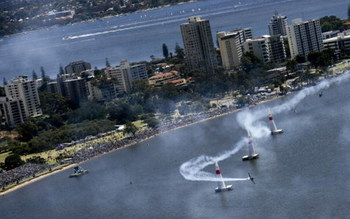 PERTH, AUSTRALIA - NOVEMBER 04: US Pilot Mike Mangold competes during the Red Bull Air Race held on the Swan River November 4, 2007 in Perth, Australia.  (Photo by Handout/Getty Images)