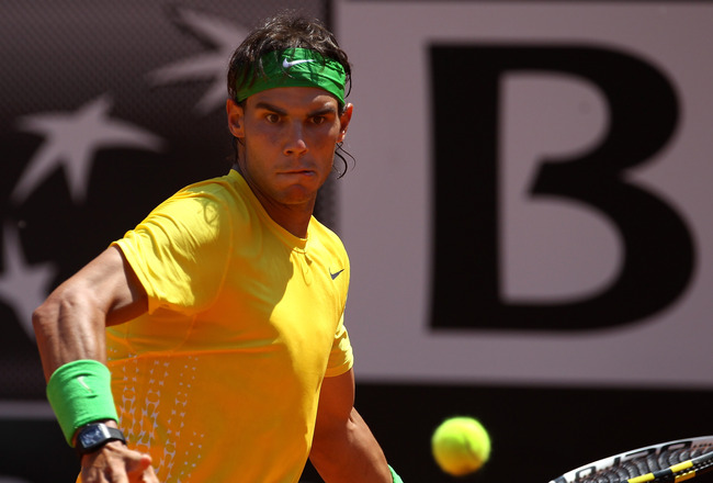 ROME, ITALY - MAY 12:  Rafael Nadal of Spain hits a forehand return during his third round match against Feliciano Lopez of Spain during day five of the Internazionali BNL d'Italia at the Foro Italico Tennis Centre on May 12, 2011 in Rome, Italy.  (Photo