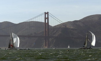 SAN FRANCISCO - SEPTEMBER 16:  Swiss Team Alinghi headed by Ernesto Bertarelli (left) and Oracle BMW Racing team headed by Larry Ellison race in front of the Golden Gate Bridge during the Moet Cup in the San Francisco Bay on September 16, 2003 in San Fran