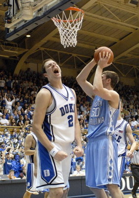 DURHAM, NC - FEBRUARY 7: Josh McRoberts #2 of the Duke University Blue Devils reacts on the court against Tyler Hansbrough #50 of the North Carolina Tar Heels during the game on February 7, 2007 at Cameron Indoor Stadium in Durham, N.C. North Carolina won