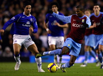 LIVERPOOL, UNITED KINGDOM - DECEMBER 07:  Ashley Young of Aston Villa in action with Mikel Arteta of Everton during the Barclays Premier League match between Everton and Aston Villa at Goodison park on December 7, 2008 in Liverpool, England.  (Photo by Cl