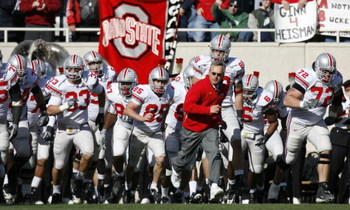 EAST LANSING, MI - OCTOBER 14:  Jim Tressel, head coach of the Ohio State Buckeyes, leads his team onto the field for a game against the Michigan State Spartans on October 14, 2006 at Spartan Stadium in East Lansing, Michigan. Ohio State won the game 38-7
