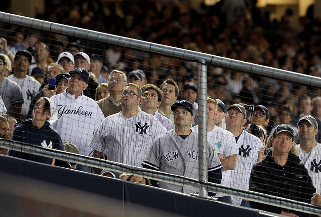 NEW YORK - SEPTEMBER 20: Fans of the New York Yankees watch a video tribute to the late team owner George Steinbrenner prior to the game against the Tampa Bay Rays on September 20, 2010 at Yankee Stadium in the Bronx borough of New York City.  (Photo by J