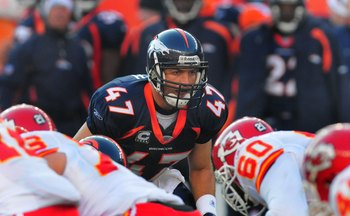 DENVER - DECEMBER 9:  John Lynch #47 of the Denver Broncos looks over the the line of of scrimmage in the second quarter of the football game against the Kansas City Chiefs at Invesco Field at Mile High on December 9, 2007 in Denver, Colorado.  (Photo by