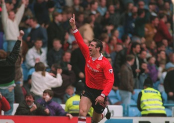 20 MAR 1993:  A PICTURE SHOWING ERIC CANTONA OF MANCHESTER UNITED SOCCER CLUB AS HE CELEBRATES SCORING A GOAL DURING THEIR MATCH AGAINST MANCHESTER CITY Mandatory Credit: Chris Cole/ALLSPORT