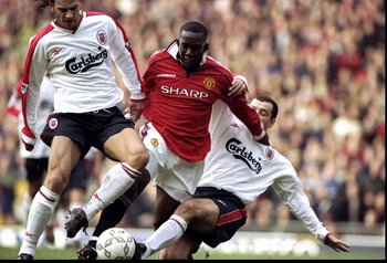 24 Jan 1999:  Dwight Yorke of Manchester United is taken out by Patrik Berger and Steve Harkness of Liverpool during the FA Cup fourth round clash at Old Trafford in Manchester, England. United won 2-1. \ Mandatory Credit: Ross Kinnaird /Allsport