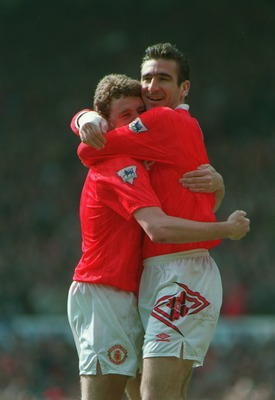 12 APR 1993:  A PICTURE SHOWING ERIC CANTONA OF  MANCHESTER UNITED SOCCER CLUB AS HE CELEBRATES A GOAL WITH TEAMMATE STEVE BRUCE DURING THEIR MATCH AGAINST CHELSEA Mandatory Credit: Steve Morton/ALLSPORT