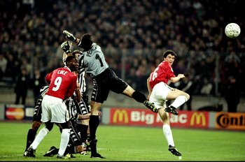 21 Apr 1999:  Manchester United captain Roy Keane gets infront of Juventus keeper Angelo Peruzzi to head home during the UEFA Champions League semi-final second leg match at the Stadio delle Alpi in Turin, Italy. United won 3-2 on the night to go through4