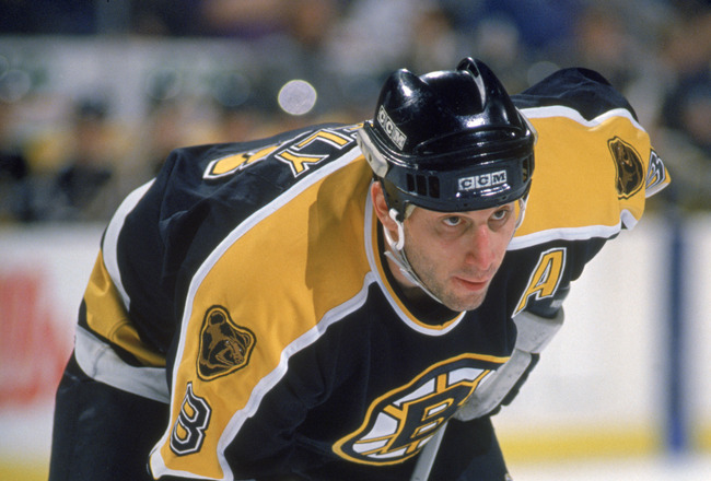 BUFFALO, NY - FEBRUARY 7:  Cam Neely #8 of the Boston Bruins lines up for the faceoff against the Buffalo Sabres at Memorial Auditorium on February 7, 1996 in Buffalo, New York. The Bruins defeated the Sabres 3-2. (Photo by Rick Stewart/Getty Images)