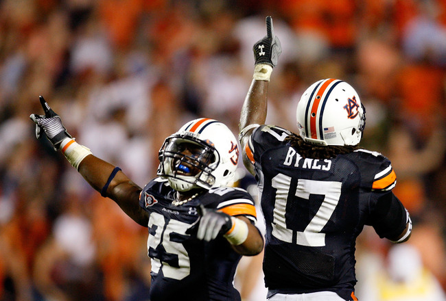 AUBURN, AL - SEPTEMBER 19:  Daren Bates #25 and Josh Bynes #17 of the Auburn Tigers celebrate Bynes interception in the final minutes of their 41-30 win over the West Virginia Mountaineers at Jordan-Hare Stadium on September 19, 2009 in Auburn, Alabama.