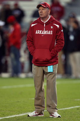 COLUMBIA, SC - NOVEMBER 06:  Head coach Bobby Petrino of the Arkansas Razorbacks watches his team during warm ups before the start of their game against the South Carolina Gamecocks at Williams-Brice Stadium on November 6, 2010 in Columbia, South Carolina
