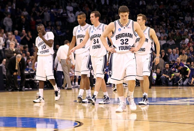 OKLAHOMA CITY - MARCH 18:  Michael Loyd Jr. #10, Brandon Davies #0, Noah Hartsock #34 and Jimmer Fredette #32 of the BYU Cougars walk on the court after Fredette turned the ball over with less then :30 sec to go in the second overtime against the Florida