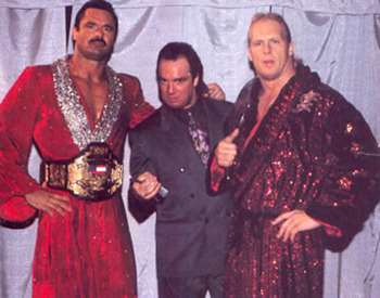 Paul E. Dangerously (c) pictured here with Rick Rude and Steve Austin