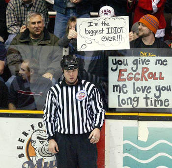 Hockey-game-referee-humorous-fan-holding-sign-biggest-idiot-ever_display_image