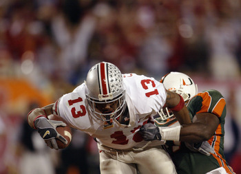 Former Buckeyes RB Maurice Clarett being brought down by a Miami defender during a short run. Clarett's TD in overtime was the difference as Miami failed to score after four attempts from the red zone.
