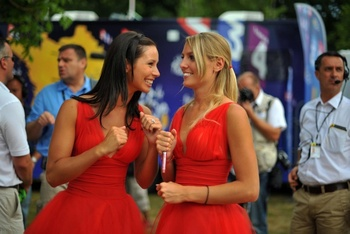 Hostesses-laura-l-and-emmanuelle-share-a-laugh-before-the-stage-11-ceremony-of-the-2009-tour-de-france