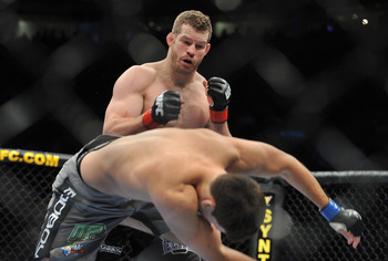 PORTLAND, OR - AUGUST 29:  UFC fighter Nate Marquardt (L) knocks out UFC fighter Demian Maia (R) during their Middleweight bout at UFC 102:  Couture vs. Nogueira at the Rose Garden Arena on August 29, 2009 in Portland, Oregon.  (Photo by Jon Kopaloff/Gett