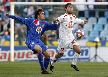GETAFE, SPAIN - MARCH 13: Ayoze Diaz of Mallorca duels for the ball with Pedro Leon of Getafe during the La Liga match between Getafe and Mallorca at Coliseum Alfonso Perez on March 13, 2010 in Getafe, Spain. (Photo by Angel Martinez/Getty Images)