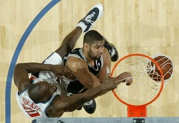 Emeka_okafor_dunks_on_tim_duncan_display_image