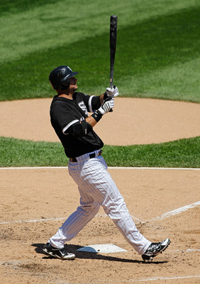 CHICAGO - JUNE 24: A.J. Pierzynski #12 of the Chicago White Sox follows the flight of the ball against the Atlanta Braves at U.S. Cellular Field on June 24, 2010 in Chicago, Illinois. The White Sox defeated the Braves 2-0. (Photo by Jonathan Daniel/Getty