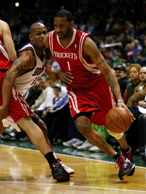 MILWAUKEE - FEBRUARY 09: Tracy McGrady #1 of the Houston Rockets collides with Keith Bogans #10 of the Milwaukee Bucks on a screen set by Yao Ming #11 on February 9, 2009 at the Bradley Center in Milwaukee, Wisconsin. The Bucks defeated the Rockets 124-11