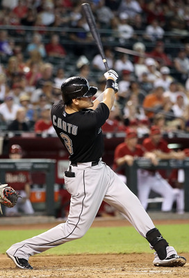 PHOENIX - JULY 11:  Jorge Cantu #3 of the Florida Marlins hits a RBI double against the Arizona Diamondbacks during the fourth inning of the Major League Baseball game at Chase Field on July 11, 2010 in Phoenix, Arizona.  (Photo by Christian Petersen/Gett