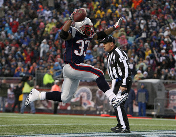 FOXBORO, MA - DECEMBER 13:  Kevin Faulk #33 of the New England Patriots  scores a 3-yard rushing touchdown in the second quarter against the Carolina Panthers at Gillette Stadium on December 13, 2009 in Foxboro, Massachusetts. (Photo by Jim Rogash/Getty I