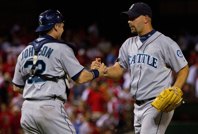 ST. LOUIS - JUNE 16: Rob Johnson #32 and David Aardsma #53 both of the Seattle Mariners celebrate beating the St. Louis Cardinals at Busch Stadium on June 16, 2010 in St. Louis, Missouri.  The Mariners beat the Cardinals 2-1.  (Photo by Dilip Vishwanat/Ge
