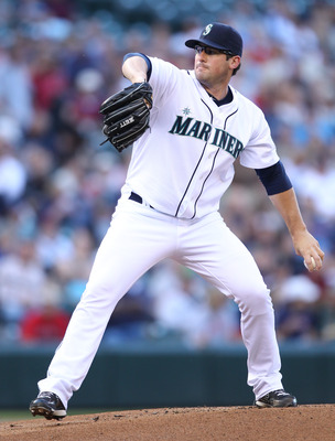 SEATTLE - JULY 22: Starting pitcher Ryan Rowland-Smith #18 of the Seattle Mariners pitches against the Boston Red Sox at Safeco Field on July 22, 2010 in Seattle, Washington. (Photo by Otto Greule Jr/Getty Images)