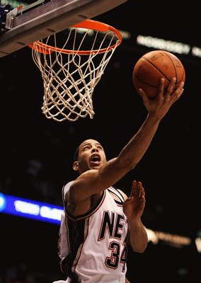 EAST RUTHERFORD, NJ - MARCH 04:  Devin Harris #34 of the New Jersey Nets shoots the ball against The Boston Celtics during their game on March 4th, 2009 at The Izod Center in East Rutherford, New Jersey.  NOTE TO USER: User expressly acknowledges and agre