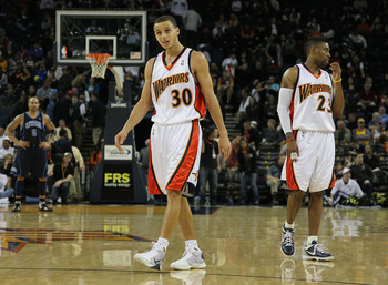 OAKLAND, CA - FEBRUARY 19:  Stephen Curry #30 and C.J. Watson #23 of the Golden State Warriors look on against the Utah Jazz during an NBA game at Oracle Arena at Oracle Arena on February 19, 2010 in Oakland, California.  NOTE TO USER: User expressly ackn