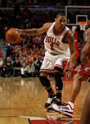 CHICAGO - APRIL 22: Derrick Rose #1 of the Chicago Bulls moves against the Cleveland Cavaliers in Game Three of the Eastern Conference Quarterfinals during the 2010 NBA Playoffs at the United Center on April 22, 2010 in Chicago, Illinois. The Bulls defeat