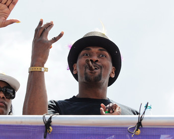 LOS ANGELES, CA - JUNE 21:  Los Angeles Lakers small forward Ron Artest waves to the fans while riding in the victory parade for the the NBA basketball champion team on June 21, 2010 in Los Angeles, California. The Lakers beat the Boston Celtics 87-79 in
