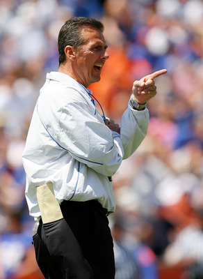 GAINESVILLE, FL - APRIL 10:  Head coach Urban Meyer of the Florida Gators coaches his team during the Orange & Blue game at Ben Hill Griffin Stadium on April 10, 2010 in Gainesville, Florida.  (Photo by Doug Benc/Getty Images)