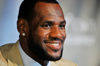MIAMI - JULY 09:  LeBron James #6, of the Miami Heat smiles during a press conference after a welcome party at American Airlines Arena on July 9, 2010 in Miami, Florida.  (Photo by Doug Benc/Getty Images)