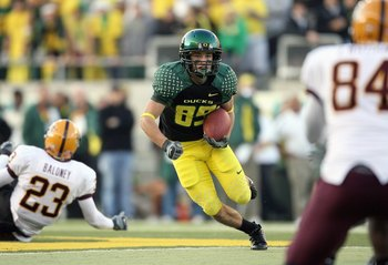 EUGENE, OR - NOVEMBER 03: Aaron Pflugrad #89 of the Oregon Ducks carries the ball during the game against the Arizona State Sun Devils at Autzen Stadium on November 3, 2007 in Eugene, Oregon. The Ducks defeated the Sun Devils 35-23. (Photo by Otto Greule