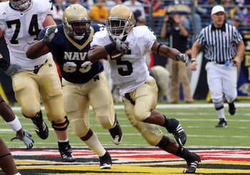 BALTIMORE - NOVEMBER 15:  Allen Armando #5 of the Notre Dame Fighting Irish runs the ball against Jordan Stephens #69 of the Navy Midshipmen on November 15, 2008 at M&T Bank Stadium in Baltimore, Maryland. Notre Dame defeated Navy 27-21.  (Photo by Jim Mc