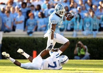 CHAPEL HILL, NC - NOVEMBER 07:  Leon Wright #7 of the Duke Blue Devils tries to tackle Greg Little #8 of the North Carolina Tar Heels during their game at Kenan Stadium on November 7, 2009 in Chapel Hill, North Carolina.  (Photo by Streeter Lecka/Getty Im