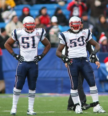 ORCHARD PARK, NY - DECEMBER 20:  Jerod Mayo #51, Gary Guyton #59 and Mike Wright #99 of the New England Patriots wait for play against the Buffalo Bills during the game at Ralph Wilson Stadium on December 20, 2009 in Orchard Park, New York. (Photo by: Ric