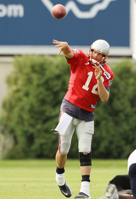 FOXBORO, MA - AUGUST 02:  Quarterback Tom Brady #12 of the New England Patriots passes the ball during training camp on August 2, 2010 at Gillette Stadium in Foxboro, Massachusetts.  (Photo by Elsa/Getty Images)