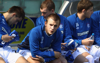 EDINBURGH, SCOTLAND - AUGUST 22:  Vladimir Weiss of Rangers sits on the bench before the Clydesdale Bank Scottish Premier League match between Hibernian and Rangers at Easter Road stadium on August 22, 2010 in Edinburgh, Scotland.  (Photo by Jeff J Mitche