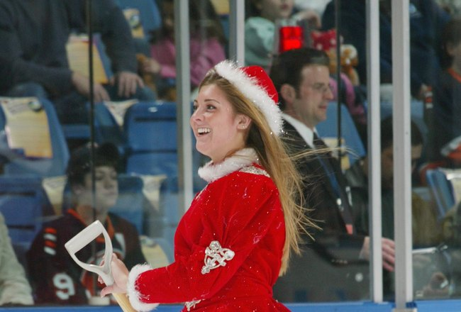 UNIONDALE, NY - DECEMBER 16:  An ice girl dressed in Christmas attire skates on the ice during a break in action of the NHL game between the Atlanta Thrashers and the New York Islanders on December 16, 2006 at the Nassau Coliseum in Uniondale, New York. (
