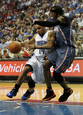 ORLANDO, FL - APRIL 21:  Jameer Nelson #14 of the Orlando Magic drives around Gerald Wallace #3 of the Charlotte Bobcats in Game Two of the Eastern Conference Quarterfinals during the 2010 NBA Playoffs at Amway Arena on April 21, 2010 in Orlando, Florida.
