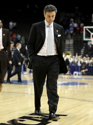 JACKSONVILLE, FL - MARCH 19: Rick Pitino the Head Coach of the Louisville Cardinals walks off of the court following the game against the California Golden Bears during the first round of the 2010 NCAA men's basketball tournament at Jacksonville Veteran's