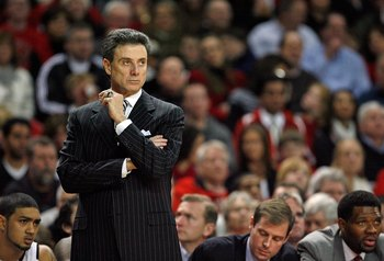 LOUISVILLE, KY - DECEMBER 30:  Rick Pitino the Head coach of the Louisville Cardinals gives instructions to his team during the Big East Conference game against the South Florida Bulls  on December 30, 2009 in Louisville, Kentucky.  (Photo by Andy Lyons/G