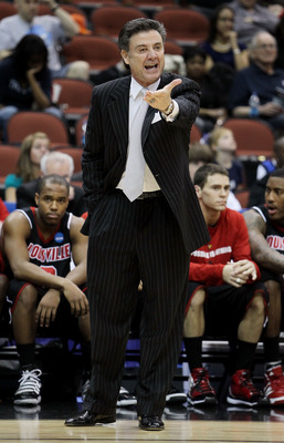 JACKSONVILLE, FL - MARCH 19:  Rick Pitino head coach of the Louisville Cardinals intructs his team against the California Golden Bears during the first round of the 2010 NCAA men's basketball tournament at Jacksonville Veteran's Memorial Arena on March 19