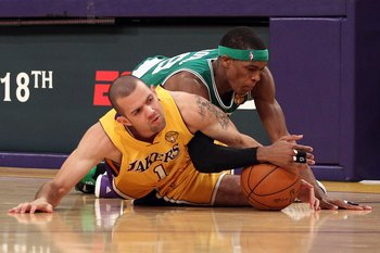 LOS ANGELES, CA - JUNE 15:  Jordan Farmar #1 of the Los Angeles Lakers and Rajon Rondo #9 of the Boston Celtics battle for a loose ball in the second half of Game Six of the 2010 NBA Finals at Staples Center on June 15, 2010 in Los Angeles, California.  N