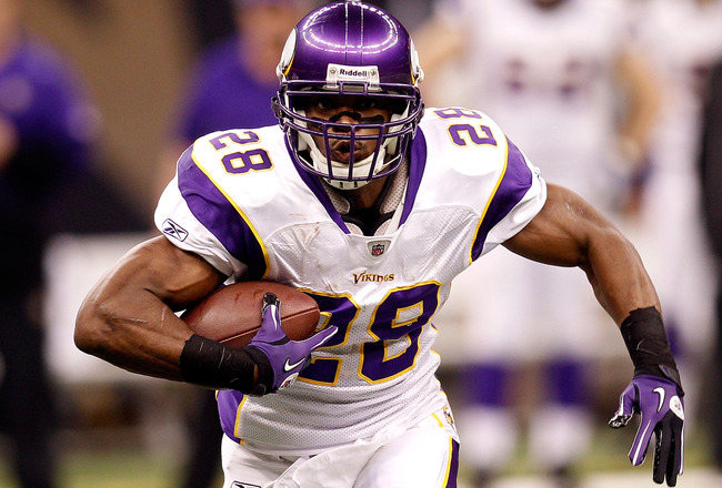 NEW ORLEANS - JANUARY 24:  Adrian Peterson #28 of the Minnesota Vikings runs the ball against the New Orleans Saints during the NFC Championship Game at the Louisana Superdome on January 24, 2010 in New Orleans, Louisiana.  (Photo by Chris Graythen/Getty