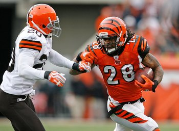 CINCINNATI - NOVEMBER 29:  Bernard Scott #28 of the Cincinnati Bengals runs with the ball  while defended by Mike Adams #20 of the Cleveland Browns at Paul Brown Stadium on November 29, 2009 in Cincinnati, Ohio.  (Photo by Andy Lyons/Getty Images)